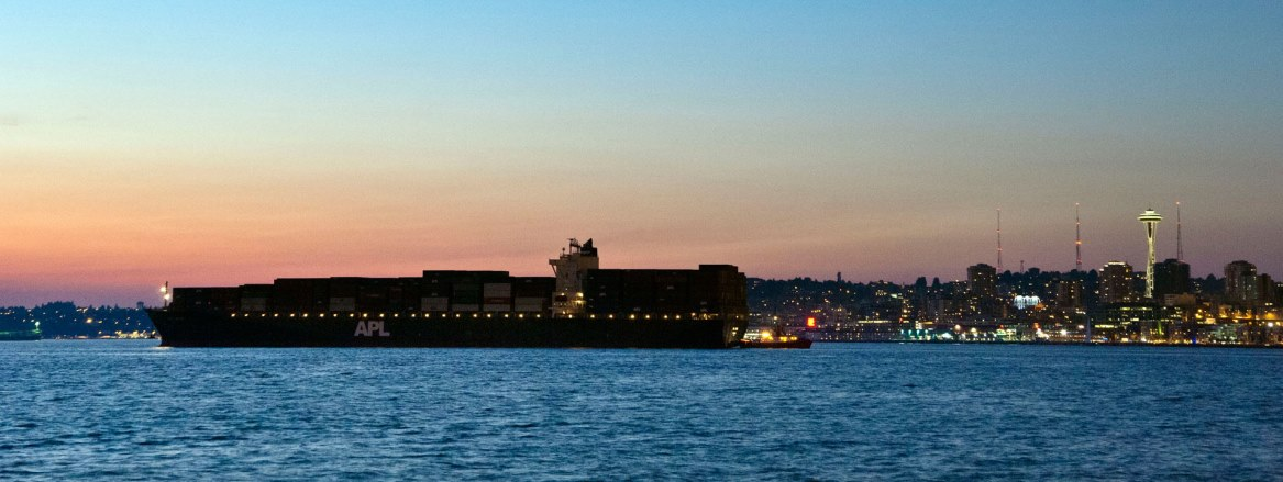 APL Spain container ship silhouetted against the Seattle skyline at sunset (Credit: Port of Seattle image by Don Wilson)
